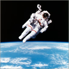Obraz na drewnie  Astronaut Bruce McCandless with propeller backpack