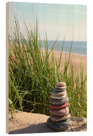 Obraz na drewnie  A tower of stones on a dune at the sea - Buellom