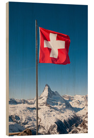 Obraz na drewnie  Matterhorn with swiss flag. Zermatt, Switzerland. - Peter Wey
