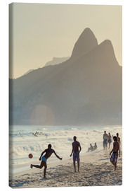Obraz na płótnie  Locals playing football on Ipanema - Alex Robinson