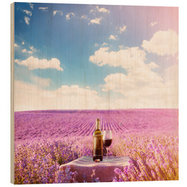 Obraz na drewnie  Red wine bottle and wine glass in lavender field