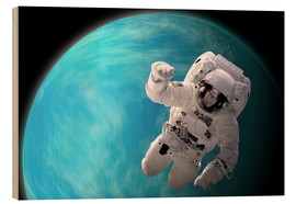 Obraz na drewnie  Artist's concept of an astronaut floating in outer space by a water covered planet. - Marc Ward