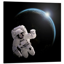 Obraz na aluminium  Astronaut floating in space as the sun rises on to Earth-like planet. - Marc Ward