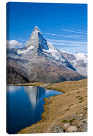 Obraz na płótnie  Hikers walking on the path beside the Stellisee with the Matterhorn reflected. Zermatt Canton of Val - Roberto Sysa Moiola