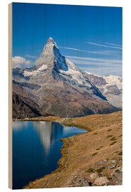 Obraz na drewnie  Hikers walking on the path beside the Stellisee with the Matterhorn reflected. Zermatt Canton of Val - Roberto Sysa Moiola