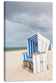 Obraz na płótnie  Seagull and beach chair, Sylt