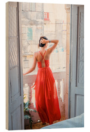 Obraz na drewnie  Young attractive woman in red dress